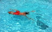 Young teenage boy swimming