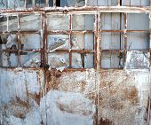 Abandoned rusty metal door of a building