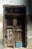 Old wooden door in ruin