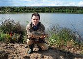 Fsherman With Fish Mirror Carp