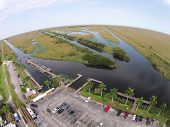 foto of airboat  - Aerial view of boat park in the Florida Everglades wetlands - JPG