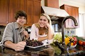 Teenage girl in kitchen with younger brother