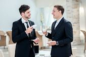 Coffee Break. Two Other Businessman Drinking Coffee And Talking To Each Other While Standing In An O