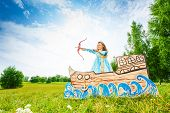Beautiful princess with bow, arrow start shooting