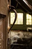 image of cobweb  - A door handle covered with cobwebs in an abandoned house - JPG