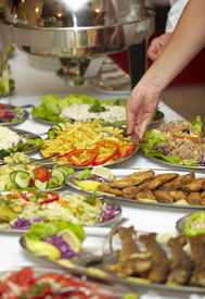 stock photo of buffet catering  - close up of buffet table arrangement catering - JPG