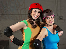 foto of roller-derby  - Pair of happy adult roller derby friends - JPG