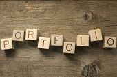 portfolio word in vintage wooden blocks