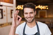 picture of waiter  - Handsome waiter smiling at camera at the cafe - JPG