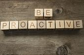 be proactive text on a wooden background