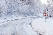 stock photo of slippery-roads  - Snow tracks on a country road and road sing showing real life - JPG