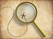 picture of treasure map  - Magnifying glass and track with marked location on old map - JPG
