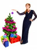Portrait Of A Beautiful Young Woman Holding A Bauble Near The Christmas Tree