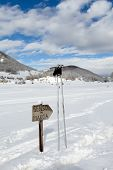 Direction Sign And Ski Poles