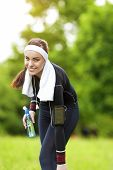 Happy Positive Caucasian Fit Woman Outdoors Making Training Exercise.