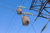 foto of voltage  - High voltage electric tower against the blue sky - JPG
