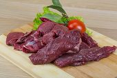 stock photo of deer meat  - Raw wild venison meat - ready for cooking ** Note: Shallow depth of field - JPG