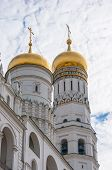Ivan the Great Bell Tower and Assumption belfry in Moscow Kremlin over blue sky, Red Square
