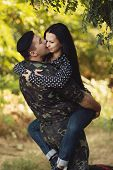 foto of say goodbye  - Woman and soldier in a military uniform say goodbye before a separation