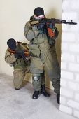 picture of ak 47  - rebels with AK 47 inside the building - JPG