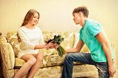 pic of sweetheart  - Young man giving flowers to his sweetheart - JPG