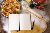 Pizza With Notebook And Ingredients