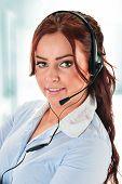 foto of helpdesk  - Call center operator in the office - JPG