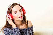 Woman With Headphones Listening Music