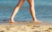Summer Vacation. Female Feet On The Beach.