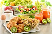 pic of buffet  - Breakfast with coffee juice croissant salad muesli and egg - JPG