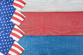 Overhead shot of American Flag napkins spread out on a red, white and blue picnic table. Horizontal format with copy space. Suitable for American Holidays: 4th of July and Memorial Day,