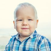 Cute caucasian baby outdoor portrait