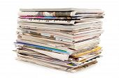 image of newspaper  - Pile of old newspapers and magazines against a white background - JPG