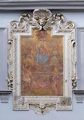 GRAZ, AUSTRIA - JANUARY 10, 2015: Virgin Mary with baby Jesus and Saints, fresco painting on the house facade in Graz, Styria, Austria on January 10, 2015.