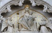 ZAGREB, CROATIA - SEPT 26, 2013: statue of Madonna on the throne with the Child Jesus and two angels, cathedral dedicated to the Assumption of Mary and to kings St Stephen and St Ladislaus