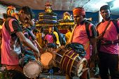 KUALA LUMPUR, MALAYSIA - FEBRUARY 3, 2015: Urumi melam drummers accompany devotees walk in a procession to the Batu Caves temple on Thaipusam day, a day of thanksgiving and devotion.