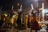 KUALA LUMPUR, MALAYSIA - FEBRUARY 3, 2015: Hindu devotees shower in the cleansing ceremony before starting prayers at the Batu Caves temple on Thaipusam day, a day of thanksgiving and devotion.