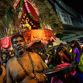 KUALA LUMPUR, MALAYSIA - FEBRUARY 3, 2015: A Hindu devotee prepares to conduct religious ritual to begin the procession to the Batu Caves temple on Thaipusam day, a day of thanksgiving and devotion.