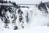 Frozen waterfall and extreme cold weather conditions make this area popular with climbers, hikers and extreme sport lovers in winter. The Montmorency Falls in winter, Quebec, Canada