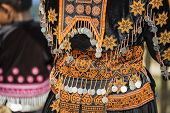 picture of hmong  - Unidentified Hmong hill tribe woman in traditional clothes in New Year festival Tak  - JPG