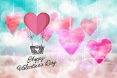 heart hot air balloon against digitally generated pink and blue girly design