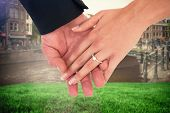 Close-up of bride and groom with hands together against sunny day in amsterdam