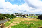 Views of the stadium and the bus station with Galle Fort