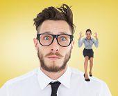 Furious businesswoman gesturing against yellow vignette