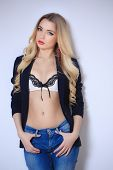 foto of denim jeans  - Beautiful blonde in a lingerie and jeans in a jacket - JPG