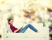 image of sofa  - technology and happy people concept  - JPG