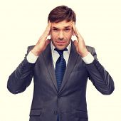 business and office, stress, problem, crisis concept - stressed buisnessman or teacher having headache