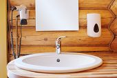 foto of mixing faucet  - White wash sink in a bathroom - JPG