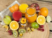 sweet juice and fruits on wood