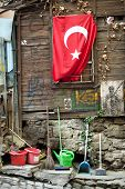 image of crescent  - Turkish flag on a wall in Istanbul is a red flag featuring a crescent with a star - JPG